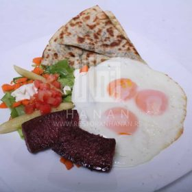 Eggs, sausage, salad, pita bread with tomato and parsley and lebanese yogurt