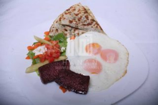 Eggs, sausage, salad, pita bread with tomato and parsley and lebanese yogurt delivery