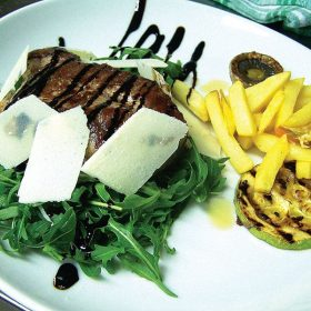 Beefsteak on rocket with parmesan