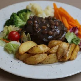 Beef steak with olive pastes