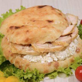 Shepherd's bun with rolled chicken and cheese