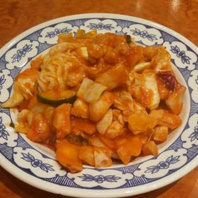 Chicken with pineapple in tomato sauce