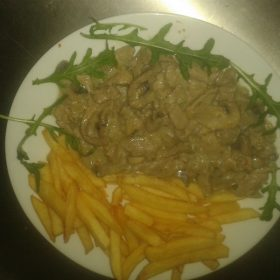 Pork in sauce with mushrooms and French fries delivery