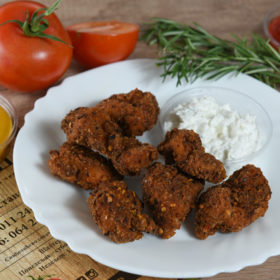 Spicy fried pieces of chicken breasts delivery
