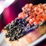 Bruschetta with tomatoes and black olive paste