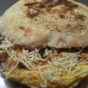 Omelet with cheese and sour cream in bun delivery