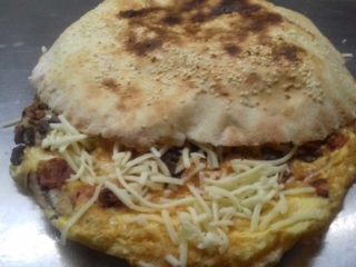 Omelet with cheese and sour cream in bun Pantela delivery