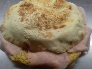 Omelet with ham, cheese and sour cream in bun delivery