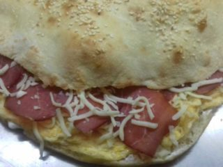 Omelet with beef prosciutto, cheese and sour cream in bun delivery