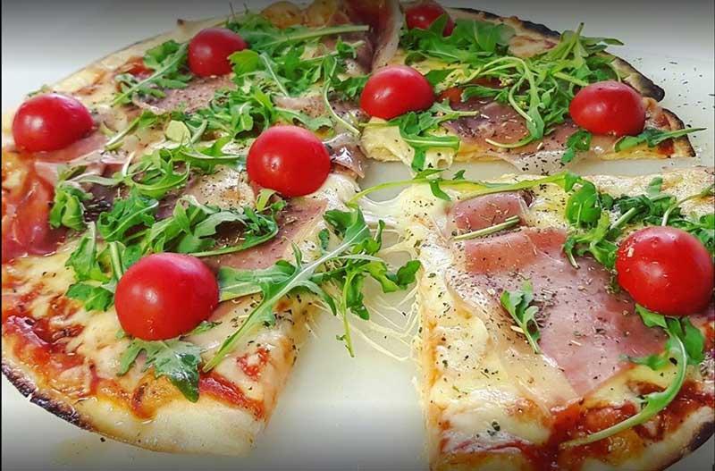 Proschiutto, rocket pizza delivery