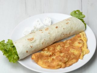 Omelet with cheese in tortilla Trpezarija salad bar delivery