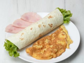 Omelet with ham in tortilla delivery