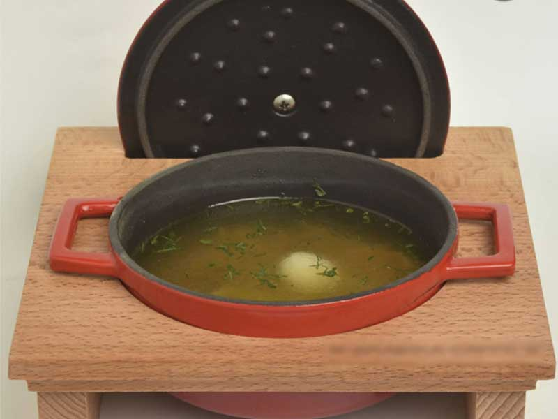 Homemade soup with egg of quail delivery
