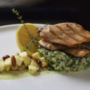 Smoked trout fillet on risotto with spinach