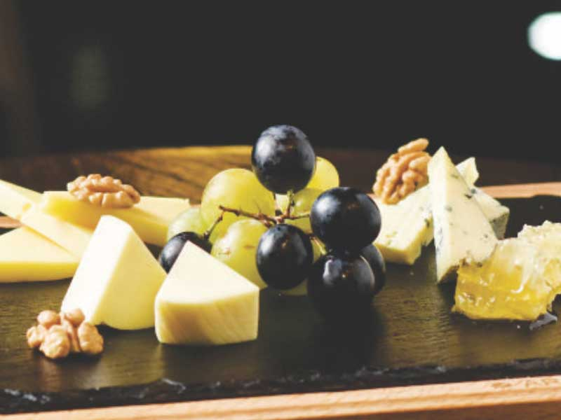 The select_ion of cheese with honey, walnuts and fruits. delivery