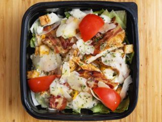 Caesar salad with chicken and parmesan leaves delivery
