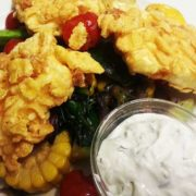 Fried goat cheese with cornflakes with vegetables