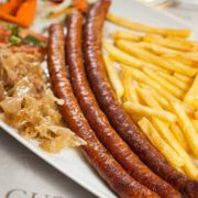 Home-made sausage with French fries