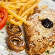 Stuffed grilled chicken with French fries