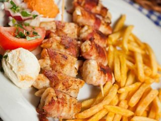 Rolled chicken kabob with French fries delivery