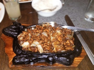 Chicken with onion on hot iron pan delivery