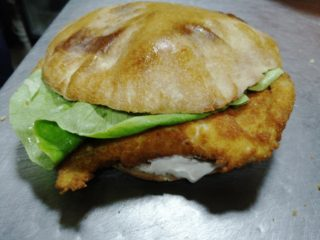 Fried chicken breasts in bun delivery