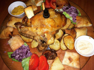 Roasted butt for two Helga's Pub Novi Beograd delivery
