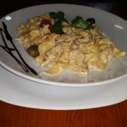 Pasta chicken fillet, curry, neutral cream, parmesan