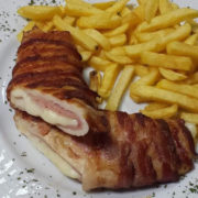 Stuffed chicken fillet rolled with bacon