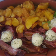 Grilled pork ribs with kajmak