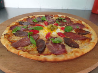 Homemade pizza Balkan Pizzeria delivery