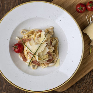 Tagliatelle with sun-dried tomatoes Cezar Restoran Picerija delivery