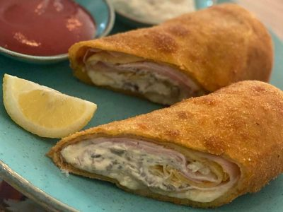 Fried pancakes with ham, mozzarella and mushroom dressing Dolce delivery
